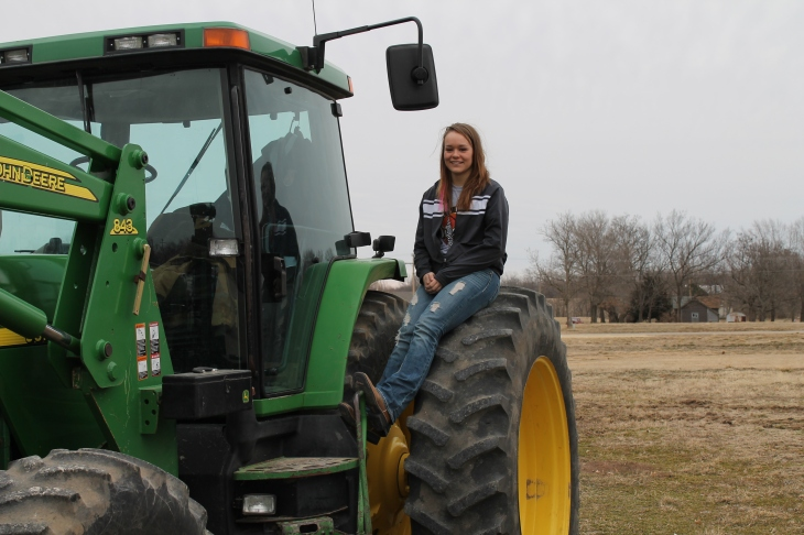 Brhett Mumma and her John Deere loader tractor.