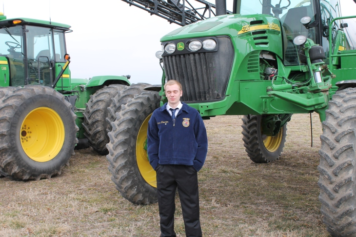 Tyler Little with his John Deere 4720 sprayer.