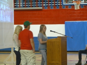 Trevor Norbury, Ashley Breckinridge, and Brittany Irwin reading the senior Prophecy.