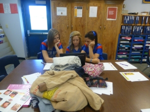 Madi, Baily, and Hayley making a FFA shirt design.